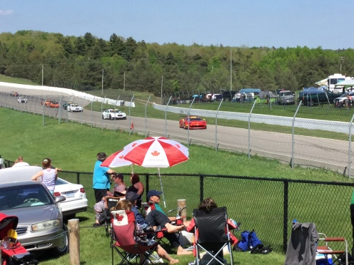 Cars racing on the Mosport track.